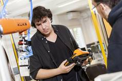 Student working with a KUKA robot