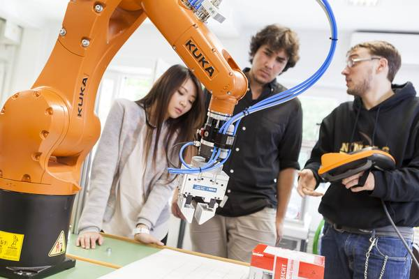 Students working with Kuka robot